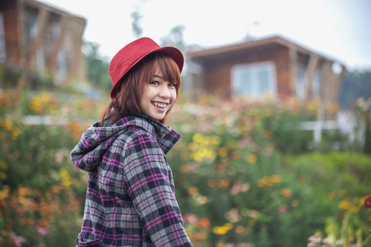 Girl in wild Brown Hair Casual Clothing Child Clothing Day Emotion Enjoyment Focus On Foreground Hair Hairstyle Happiness Looking At Camera Nature One Person Outdoors Portrait Smiling Standing Teeth Toothy Smile Waist Up