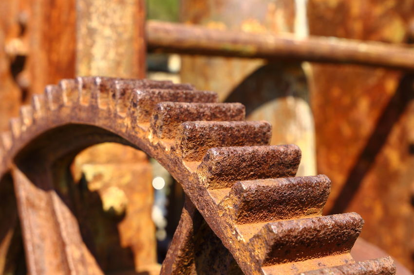 Many teeth in the wheel Cogsweel Corrosion Drive Wheel Machinery Old Machines Rust Rusted Metal Texture, Metal Exposed To Time, Rusty Old Metal, Metal Background. Rusty Teeth Abandoned Bad Condition Close-up Cogs Damaged Focus On Foreground Gear Gear Wheel Metal No People Old Cranes Old-fashioned Outdoors Pattern Rusted Rusty Teeth