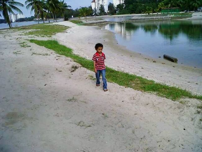 Full Length Child One Person Nature Water Outdoors Beach Day Beach Walk Beach View Walking On The Beach Walking Alone... Enjoying The Moment Water Reflection Sand & Sea Trees Beauty In Nature Fresh Air... Nice Day Nice Place Holiday Destination