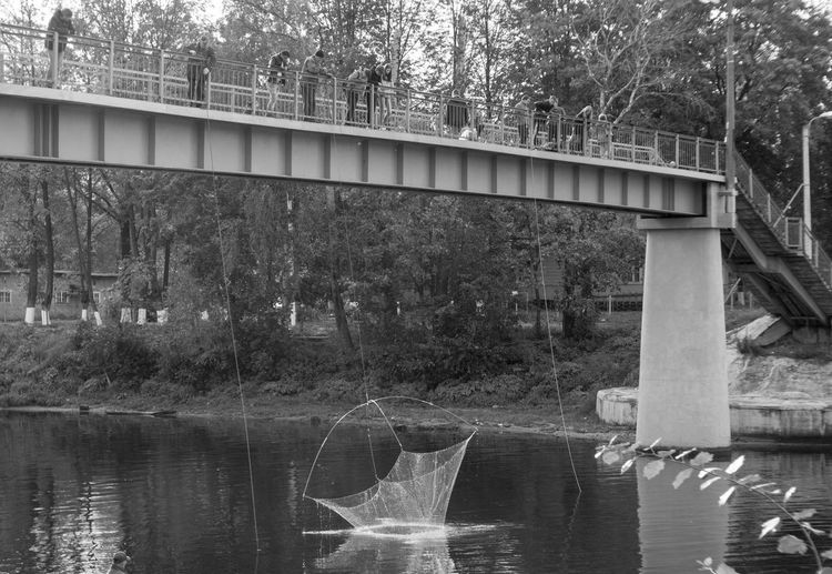Fishing from the bridge Architecture Blackandwhite Bridge - Man Made Structure Built Structure Day Fisherman Nature River Waterfront