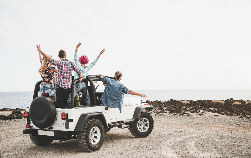 Group of friends driving off road convertible car during roadtrip - Happy travel people having fun in vacation - Friendship, transportation and youth lifestyle holidays concept Adventure ASIA Australia Beach California Car Celebrate Convertible Driving Excursion Friends Friendship Fun Group Happy Hipsters Holidays Journey Laughing Lifestyle Media Men Millenial Millennial Mobile Nature Offroad Outdoor Party People RENT Road Sea Smiling Social South America SPAIN Summer Tourism Tourist Travel Traveler Trip Vacation Vehicle Wanderlust Wheel Women Young Youth