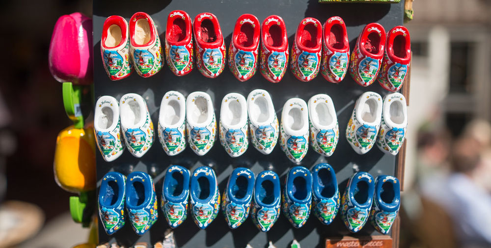Famous Dutch wooden shoes for sale Abundance Arrangement Close-up Collection Colorful Cultures Day Focus On Foreground In A Row Large Group Of Objects Multi Colored No People Outdoors Selective Focus Side By Side Variation
