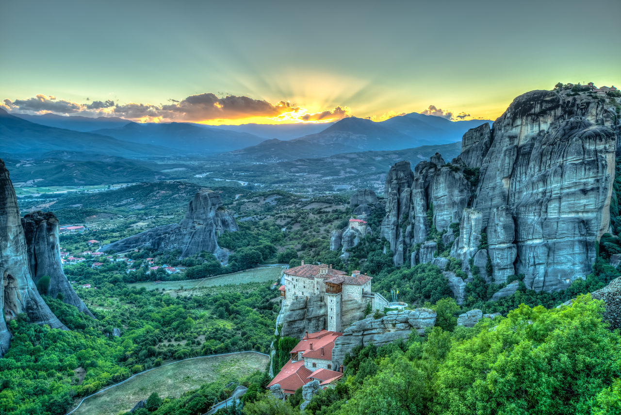 Spectacular colorful sunset over the valley of Meteora, from the best view point, a rock called Psaropetra, Kalambaka, Meteora, Central Greece. Monastery Beauty In Nature Cold Temperature Day Greece Landscape Meteore Mountain Mountain Range Nature No People Outdoors Scenics Sky Tranquil Scene Tranquility Tree