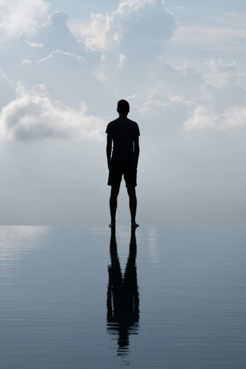 One Person Cloud - Sky Water Sky Rear View Sea Beauty In Nature Real People Nature Standing Horizon Over Water Tranquility Full Length Silhouette Men Leisure Activity Reflection Horizon Waterfront Outdoors Contemplation Capture Tomorrow