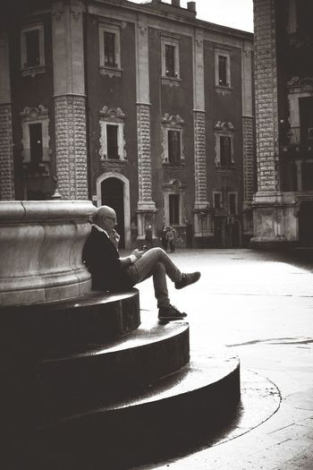 Public Space Style Streetphotography Square Shadows & Lights Piazza One Man Only Reading Communication Sitting Fountain Morning Light Blackandwhitephotography City Architecture Building Exterior Historic Civilization
