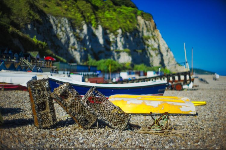 Cliffs Holiday Travel Beach Beauty In Nature Blue Sky Boat Day England Focus On Foreground Moored Mountain Nature Nautical Vessel No People Outdoors Pebbles Sailboat Sea Sky Transportation Uk Vintage Water Yellow