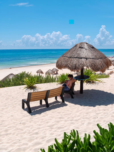 Caribbean beach and turquoise sea for a paradise landscape in Cancun, Playa delfines, Quintana Roo, Mexico Canon Cancun Mexico White Sand Land Beach Sea Water Nature Sunlight Sky Sand Beauty In Nature Horizon Horizon Over Water Day Chair Vacations Trip Shadow Men Scenics - Nature Lounge Chair Outdoors
