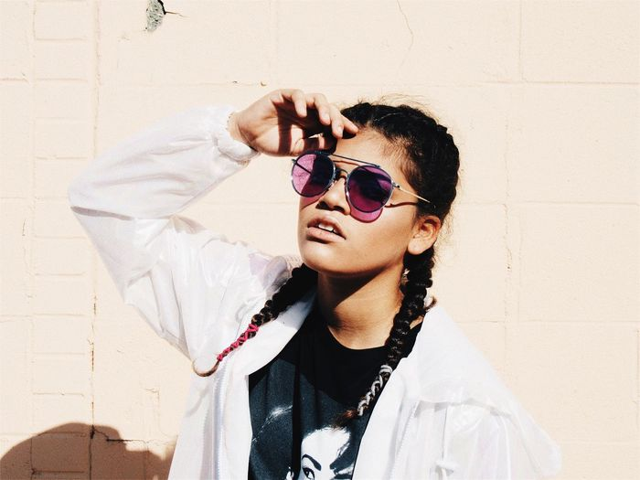 Pastel Walls Sunglasses One Person Real People Young Adult Young Women Leisure Activity Outdoors Standing Lifestyles Day People Teenage Girls Teen Braid Fashion Model Modern Architecture Modern First Eyeem Photo The Week On EyeEm