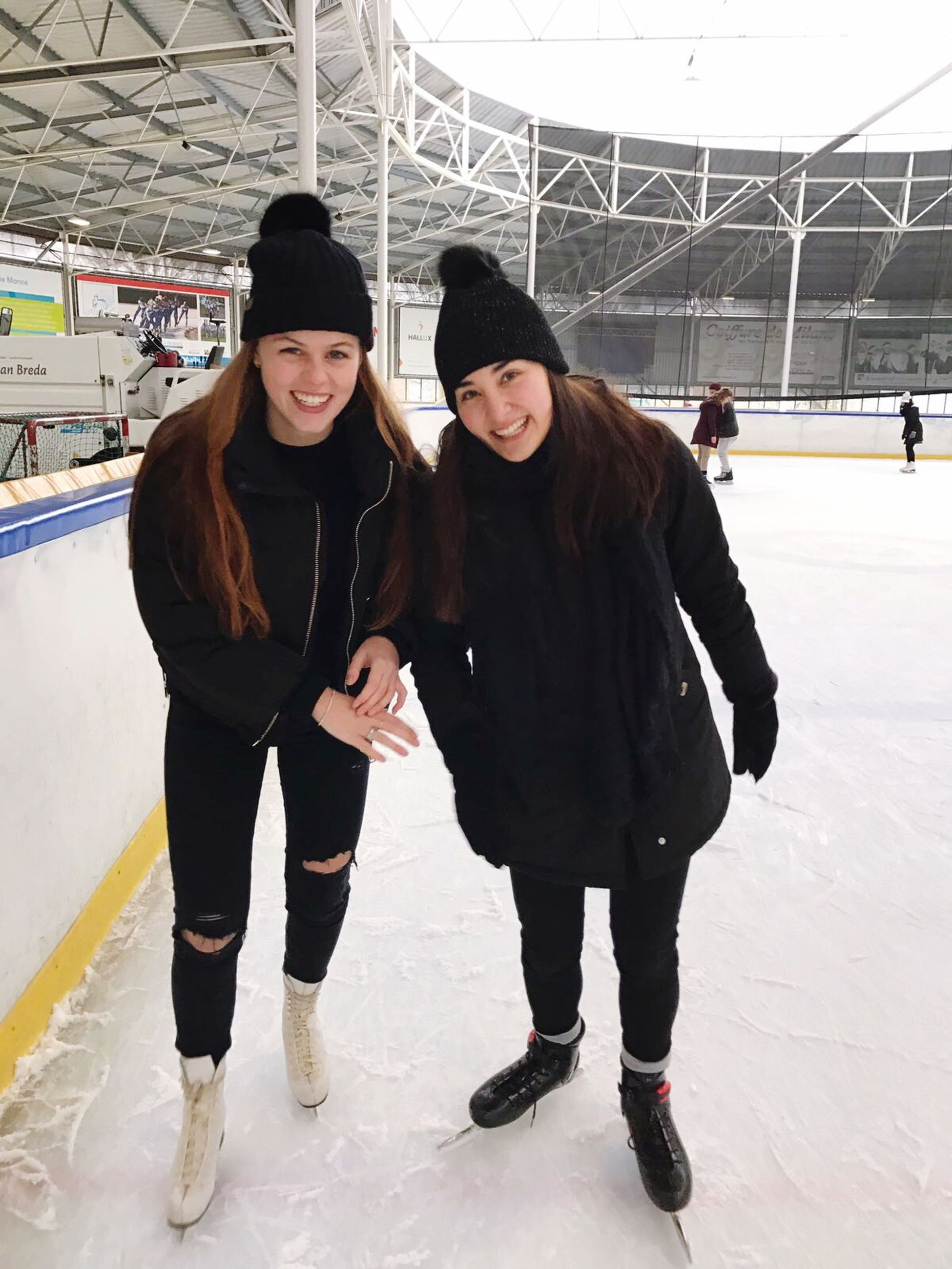 winter, togetherness, sport, two people, recreational pursuit, friendship, happiness, smiling, cold temperature, bonding, portrait, warm clothing, people, leisure activity, cheerful, stadium, men, sports clothing, young adult, adult, outdoors, ice rink, adults only, day
