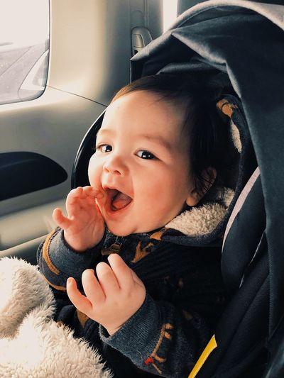 Portrait of cute baby girl in car
