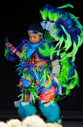 Young Dancer First Nations Traditional Culture Traditional Clothing Black Background Child Cultural Dance Cultural Heritage Dancing Boy Front View Indigenous Culture Indigenous People Multi Colored Native American One Person Portrait Regalia Stage Standing Symbolic  The Portraitist - 2018 EyeEm Awards