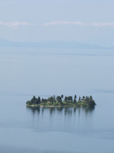 Africa Lake Kivu Upright Island Blue Floating In The Middle Of Nowhere In Thin Air No Land In Sight Lost Island Alone Isolated Water Scenics - Nature Tranquil Scene No People Reflection