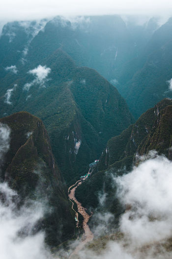 Exploring the magical Inca site - Machu PIcchu. Ancient Inca Latin America Misty Morning Travel Aguas Calientes Beauty In Nature Civilization Clouds Day Environment Fog Idyllic Moody Nature No People Non-urban Scene Outdoors Plant South America Tranquility Travel Destinations Valley Water