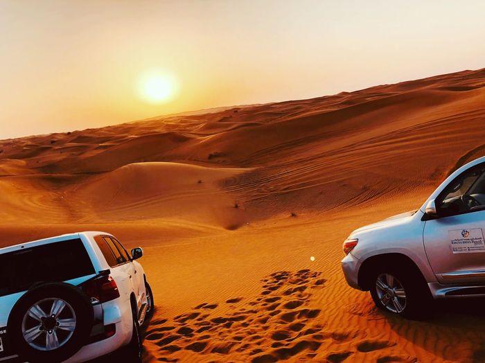 Vintage car on desert against clear sky