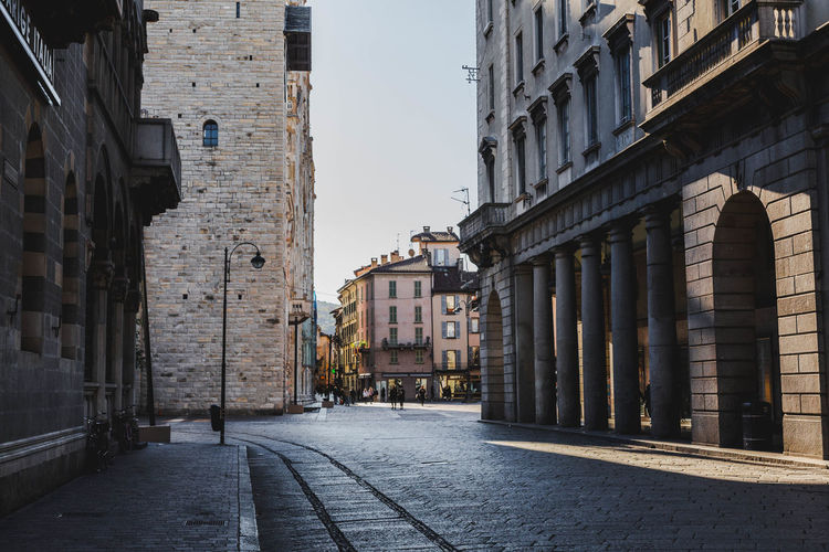 Milan Cathedral. Architecture Building Exterior Built Structure Building City The Way Forward Direction Street Residential District Day No People Sky Outdoors Nature Footpath Transportation Narrow Alley Window Empty Long Vacations Hoilday Italy Shadow