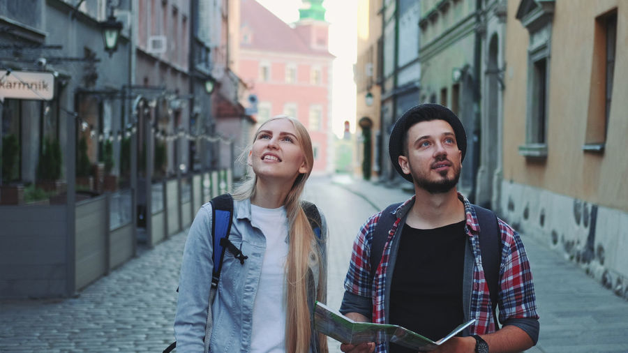 Young couple standing on street in city