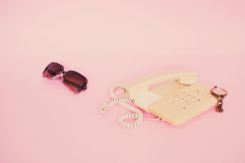Pink Color Studio Shot Indoors  No People Pink Background Colored Background Copy Space Fashion Still Life Cut Out Jewelry Group Of Objects Sandal Sunglasses Three Objects Wood - Material Container Wealth Communication Retro Retro Styled Minimalism