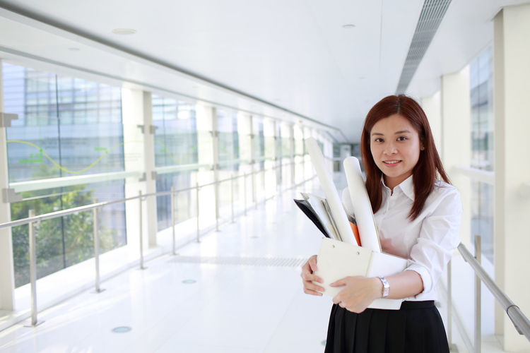 Lady Office Portrait Of A Woman Quiet Moments Work Worker Workers Girl Job Jobs Leaves Occupation Occupational Safety And Health Office Building One Person Pose Real People Woman Portrait Young Adult Young Women