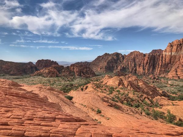 Landscape of orange and red rock formations and hills in Utah Snow Canyon State Park Tranquil Scene Sky Scenics - Nature Landscape Environment Tranquility Cloud - Sky Rock Formation Desert Non-urban Scene Day Land Rock - Object No People Beauty In Nature Solid Climate Geology Nature Rock
