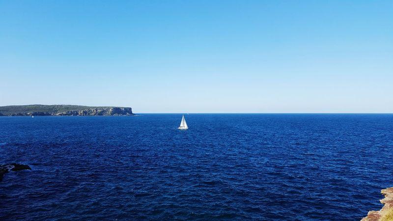 Blue ocean, white boat Sydney