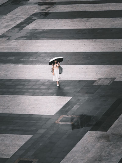 High angle view of a woman walking on the street.