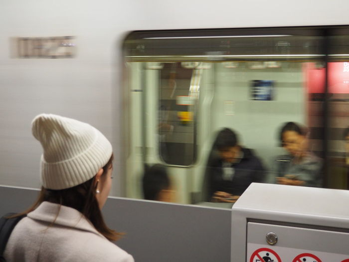 Day Headshot Indoors  Journey Men Mode Of Transport One Person People Public Transportation Real People Rear View Sitting Subway Station Subway Train Technology Tokyo Train - Vehicle Transportation White Color White Hat Women Young Adult