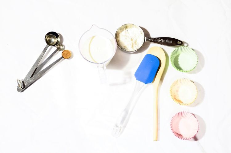 Cooking ingredients flat lays Studio Shot White Background Still Life Food And Drink Spoon Fork High Angle View Food No People Freshness Healthy Eating Close-up Raw Ingredients Cooking Flat Lays Flatlay Flat Lay Cooking Ingredient Flour Milk Cooking Utensil Wooden Spoon White Backround