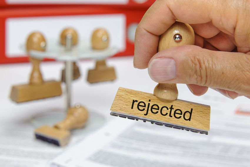 rejected printed on rubber stamp in hand Business Print Result Close-up Concept Conceptual Decision Declination Declined Defeat Denial Denied Dismissal Dismissed Failure  Hand Human Hand Refusal Refused Reject Rejected Rejection Request Stamp Text