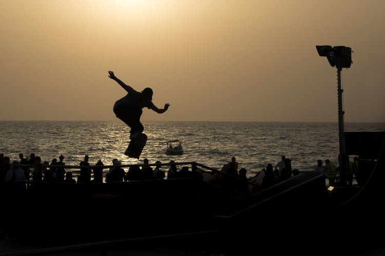 One of the events of the sea destination in Jeddah EyeEmNewHere Jeddah Jeddah Beach Jeddah City Beauty In Nature Clear Sky Horizon Horizon Over Water Jeddah_ksa Leisure Activity Lifestyles Men Nature Outdoors People Real People Scenics - Nature Sea Silhouette Sky Standing Sun Sunset Water EyeEmNewHere Summer Exploratorium Adventures In The City The Photojournalist - 2018 EyeEm Awards The Great Outdoors - 2018 EyeEm Awards