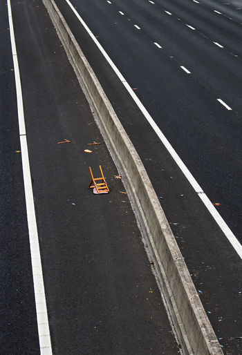 High angle view of abandoned chair on highway