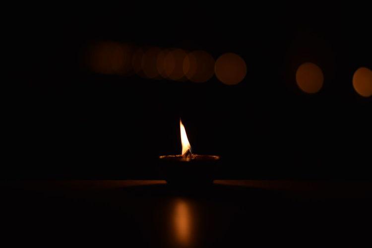 From dark to light! Series Lens Flare Primeshots Nikon Diya DOPE Natural Glory Shine Rise Diya - Oil Lamp Diwali Oil Lamp Illuminated Flame Burning Celebration Heat - Temperature Traditional Festival Tradition Candlelight Lit Firework Bulb Light Fire Entertainment Glowing Darkroom Fire - Natural Phenomenon