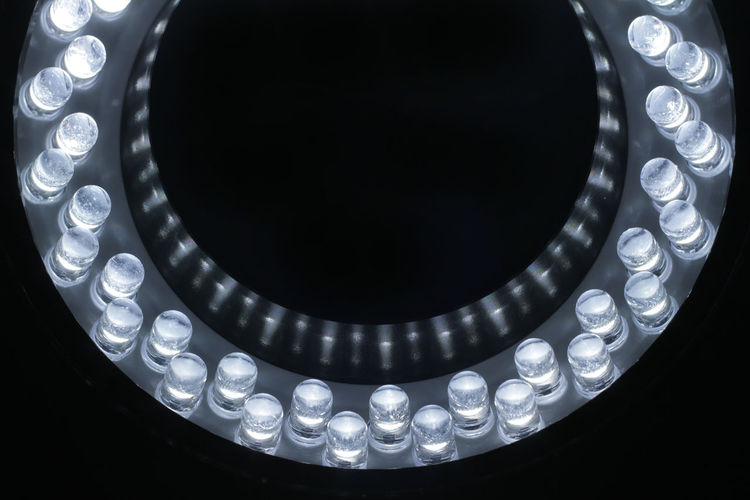 Close-up of illuminated white led lights against black background