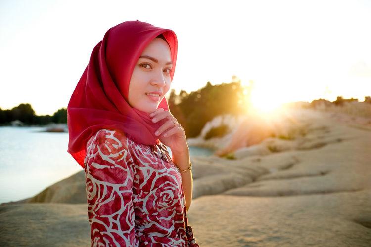 Portrait of hijab girl EyeEmNewHere Women Beach Water Portrait Red Sunset Sea Standing Sunlight Hood - Clothing Sand Sandcastle