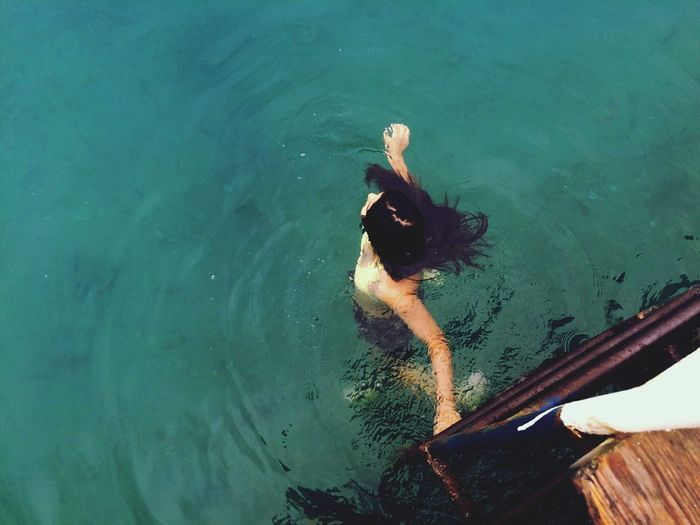 High Angle View Of Woman Swimming In Lake