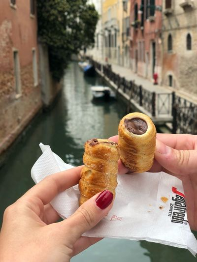 Honeymoon in Venice Human Hand Hand Holding Human Body Part One Person Personal Perspective #NotYourCliche Love Letter Food And Drink Real People Architecture Food Built Structure City Canal Water Lifestyles Day Focus On Foreground Finger Body Part Temptation