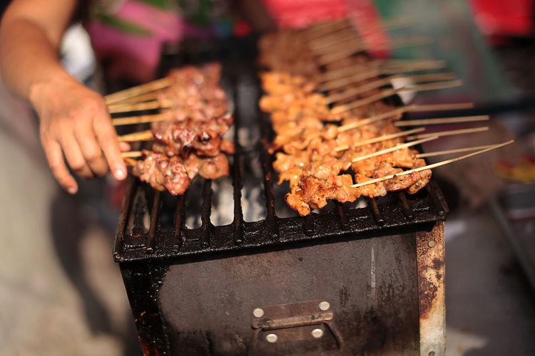 Thai Style BBQ Pork Asian Food Bangkok BBQ Close-up Cooking Food Freshness Hawkerfood Heat - Temperature Holding Person Preparation  Satay Skill  Street Food Worldwide