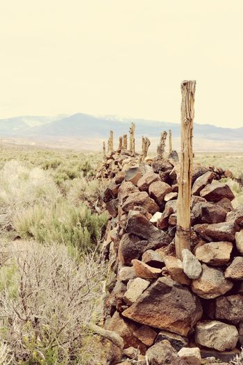 Scenics Tranquility No People Outdoors Desert Mountain Western Non-urban Scene The Past Rural Scene wall rocks posts