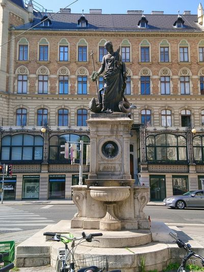 Statue of fountain in city