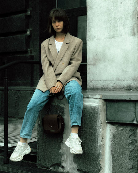 Portrait of teenage girl sitting on seat
