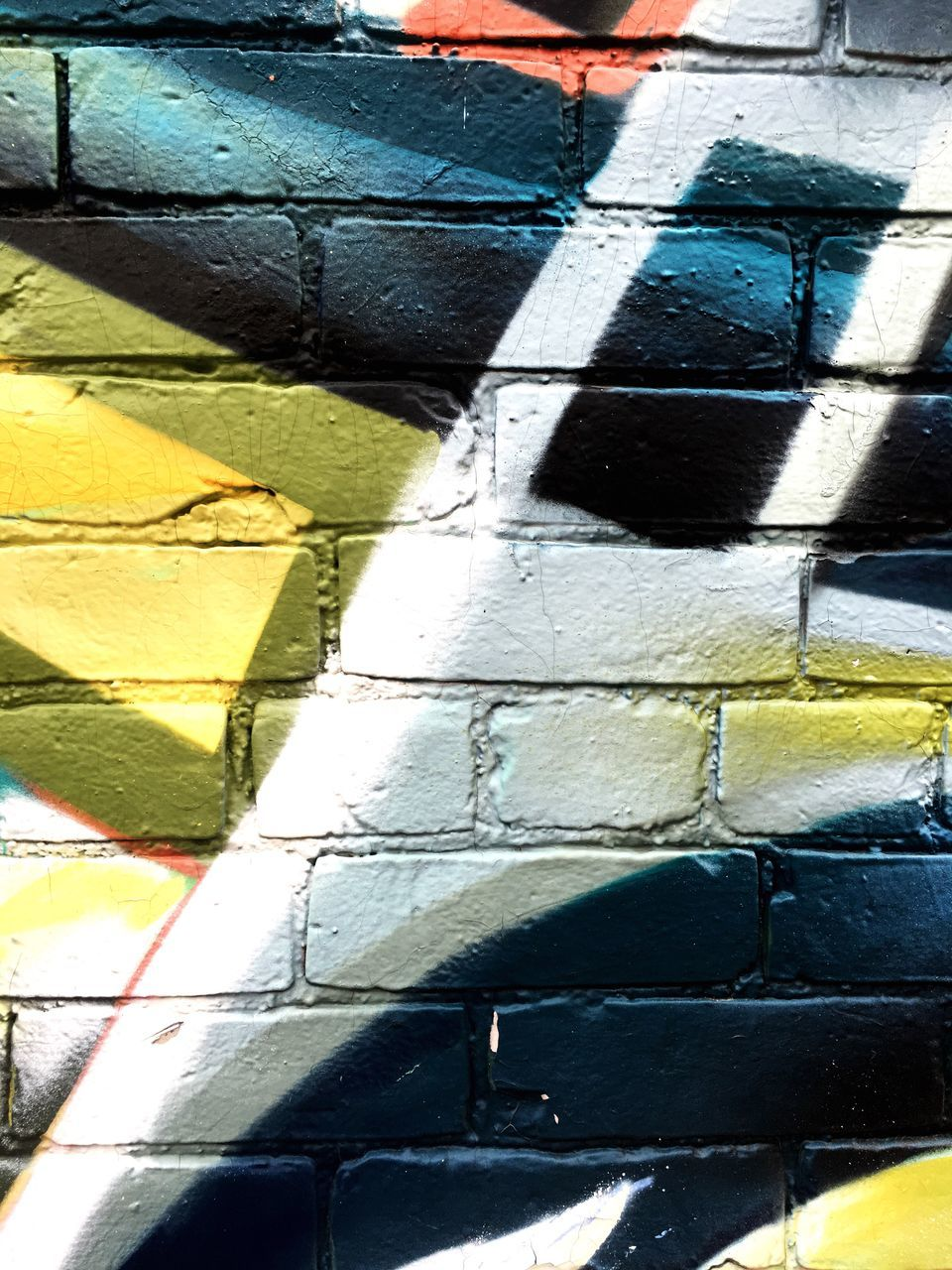 graffiti, full frame, multi colored, backgrounds, yellow, day, outdoors, street art, paint, built structure, no people, close-up, architecture, aerosol can