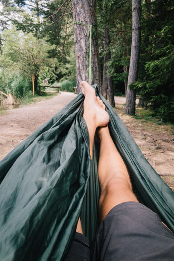 Balkan Roadtrip barefoot Body Part Day Europe Forest Human Body Part Human Foot Human Leg Human Limb Land Leisure Activity Low Section Men Nature One Person Outdoors Personal Perspective Plant Real People Relaxation Roadtrip Tree