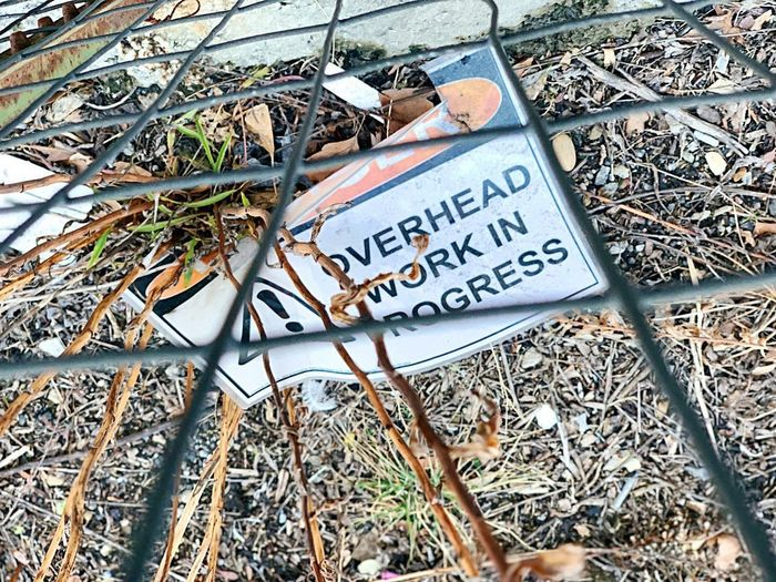 Overhead Work Communication Text Western Script Day Sign No People Outdoors High Angle View Information Metal Information Sign Twig
