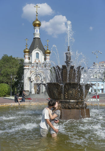 Russia, Yekaterinburg, fountains, heat, youth Architecture Built Structure Casual Clothing Cloud Cloud - Sky Day Leisure Activity Lifestyles Outdoors Rippled Russia, Yekaterinburg, Fountains, Heat, Youth Sky Tourism Tourist Travel Destinations Vacations Water