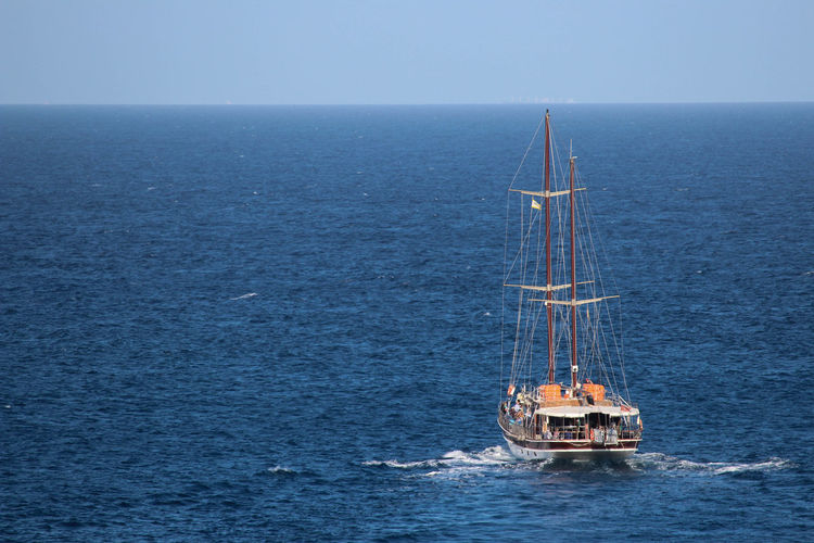 Blue Sea Blue Wave Sailing Ship Ship At Sea Beauty In Nature Blue Blue Sky Day Horizon Over Water Nature Nautical Vessel No People Offshore Platform Outdoors Sailing Sailing Boat Sea Sea And Sky Sea View Ship Ships Sky Water