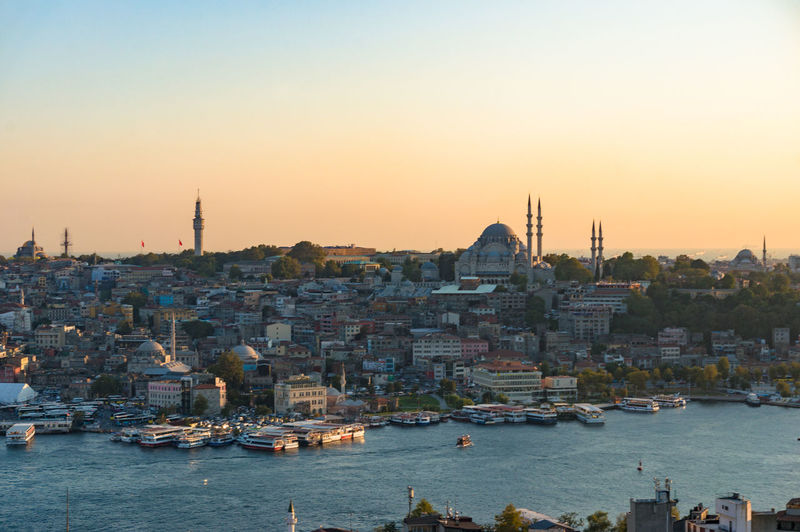 Historic Fatih district with Eminonu station on Golden Horn bay. Istanbul, Turkey ASIA City Cityscape East Istanbul Local Middle East Panorama Pier Skyline Turkey Authentic Bosporus Building Capital City District Dock Fatih Historic Landscape Megalopolis Mosque Populated Sunset Water