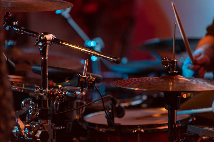Close-up of drum and cymbal on stage