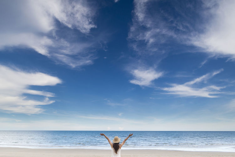 Freedom see Sky Water Sea Horizon Horizon Over Water Cloud - Sky One Person Beach Beauty In Nature Human Body Part Day Nature Land Blue Body Part Leisure Activity Lifestyles Scenics - Nature Outdoors Human Arm