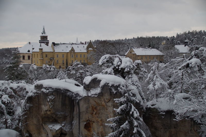 Hrubá Skála castle in winter, Czechia Architecture Beauty In Nature Building Exterior Built Structure Central Europe Central European Climate Cloudy Cold Temperature Czech Republic Czechia House Nature No People Outdoors Scenics Snow Travel Destinations Tree Winter