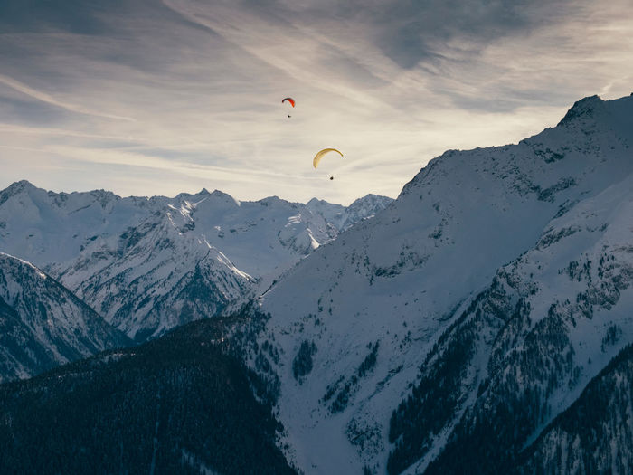 Austria Adventure Mountain Sport Paragliding Parachute Winter Sky Beauty In Nature Extreme Sports Scenics - Nature Unrecognizable Person Leisure Activity Mountain Range Cold Temperature Snow Non-urban Scene Mid-air Cloud - Sky Nature Snowcapped Mountain Outdoors The Great Outdoors - 2019 EyeEm Awards