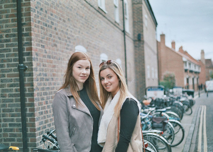 A 35 mm shot from my Generation Z series shot in York - Shot on Canon T70 #NotYourCliche Redhead Adult Adults Only Architecture Bicycle Blond Hair Building Exterior Built Structure City City Life Day Friendship Mode Of Transport Outdoors People Real People Sidewalk Smiling Street Togetherness Transportation Two People Young Adult Young Women Stories From The City